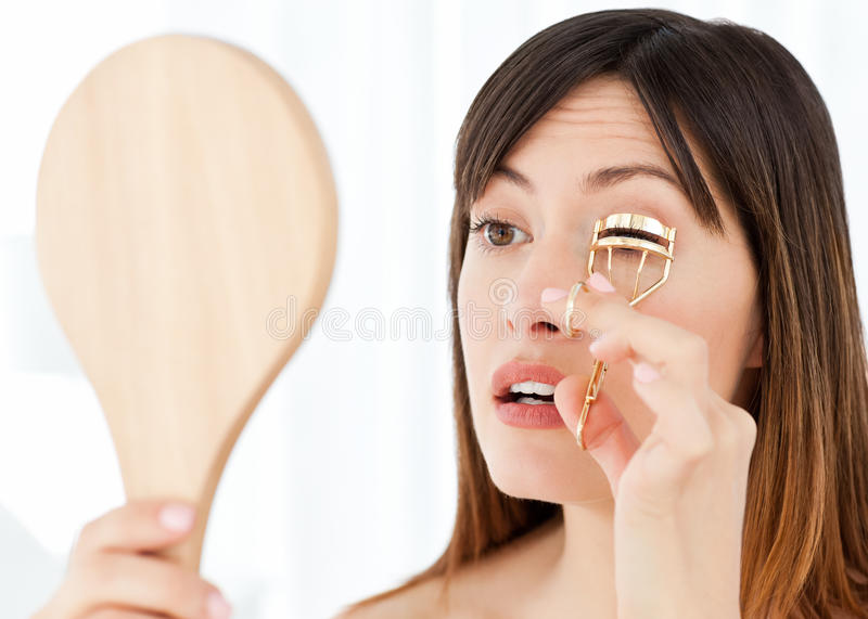 Download Woman Curling Her Eyelashes Stock Photo - Image: 17937642