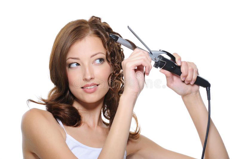 Download Woman Curling Her Hair With Roller Stock Photo - Image: 10165966