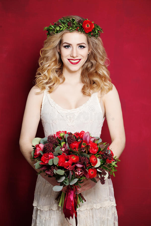 Woman with Curly Blond Hair. Bride with Flowers. Fashion Woman with Curly Blond Hair. Bride with Flowers royalty free stock image