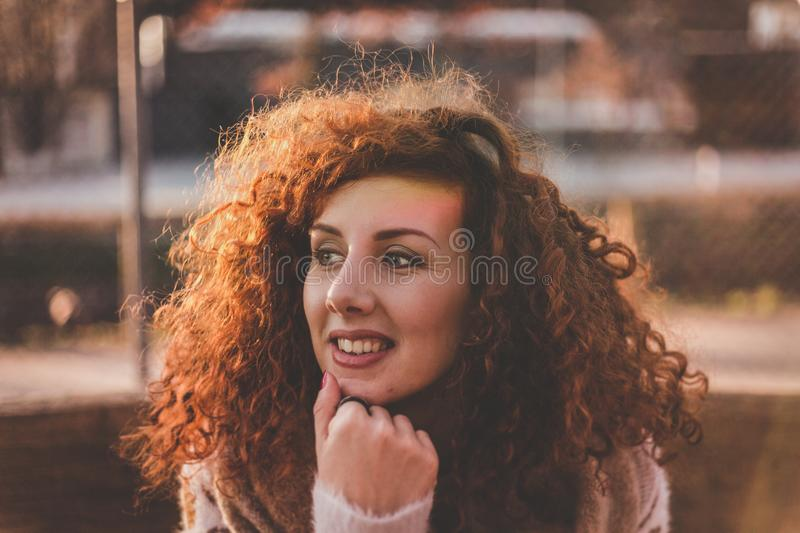 Woman Curly Hair With White Long-sleeved Top royalty free stock image