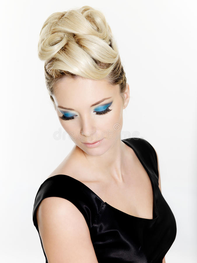 Woman with curly hairstyle and blue make-up stock photography