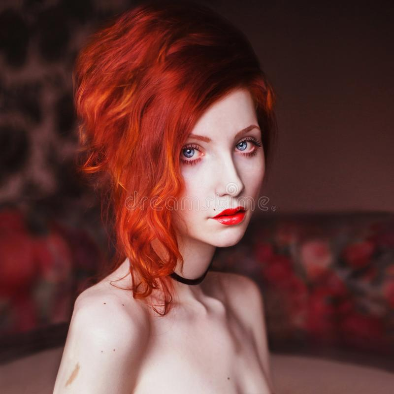 Beautiful girl with red hair royalty free stock photo