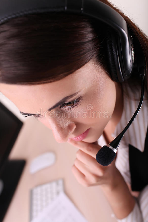 Woman customer service worker, call center operator with phone h stock image