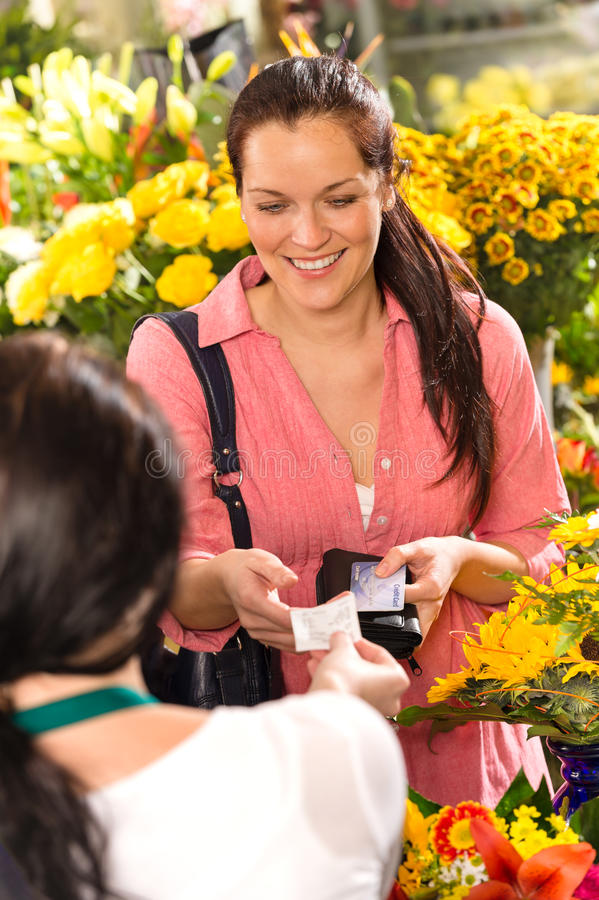 Woman customer taking receipt flower shop buying stock photography