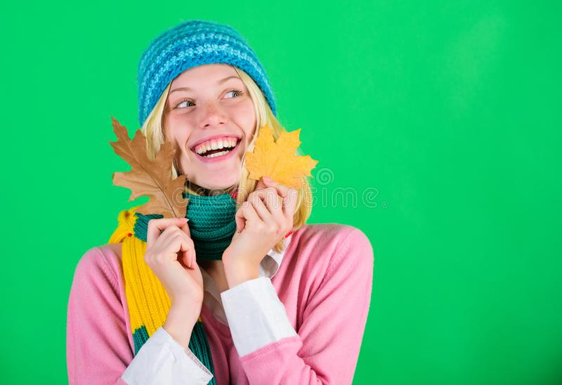 Woman cute face wear knitted hat hold fallen leaves. Time to rejuvenate and repair skin. Healthy skin. How to update stock image