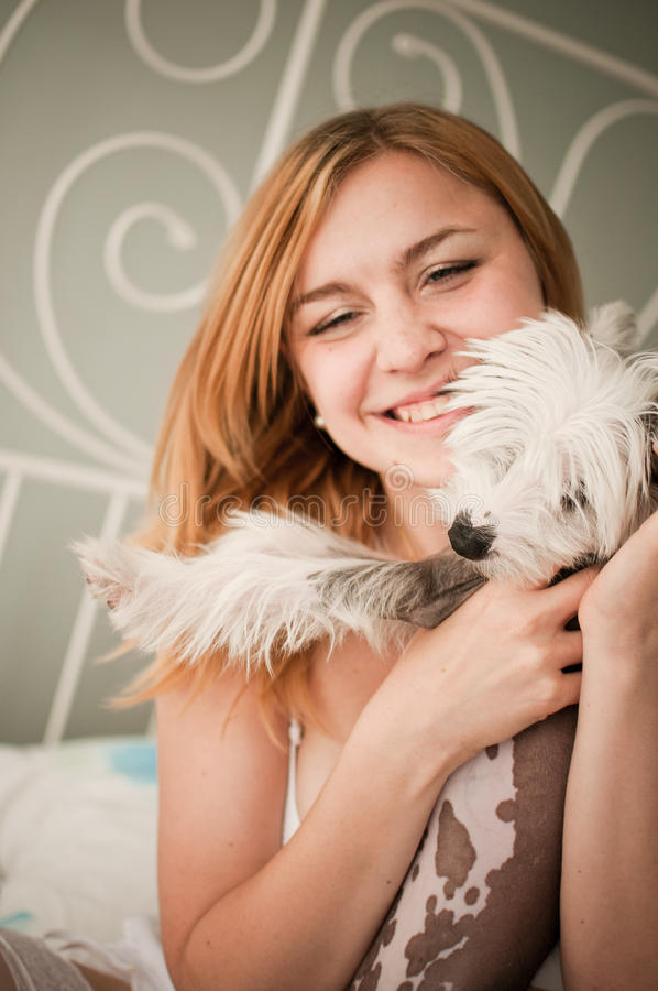 Woman With A Cute Little Dog Stock Photos
