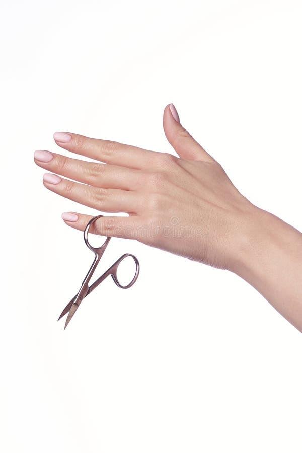 Woman cuts nails scissors, close up stock photo