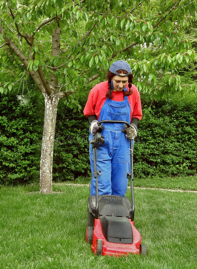 Download Woman cutting the grass stock image. Image of carefree - 14123203