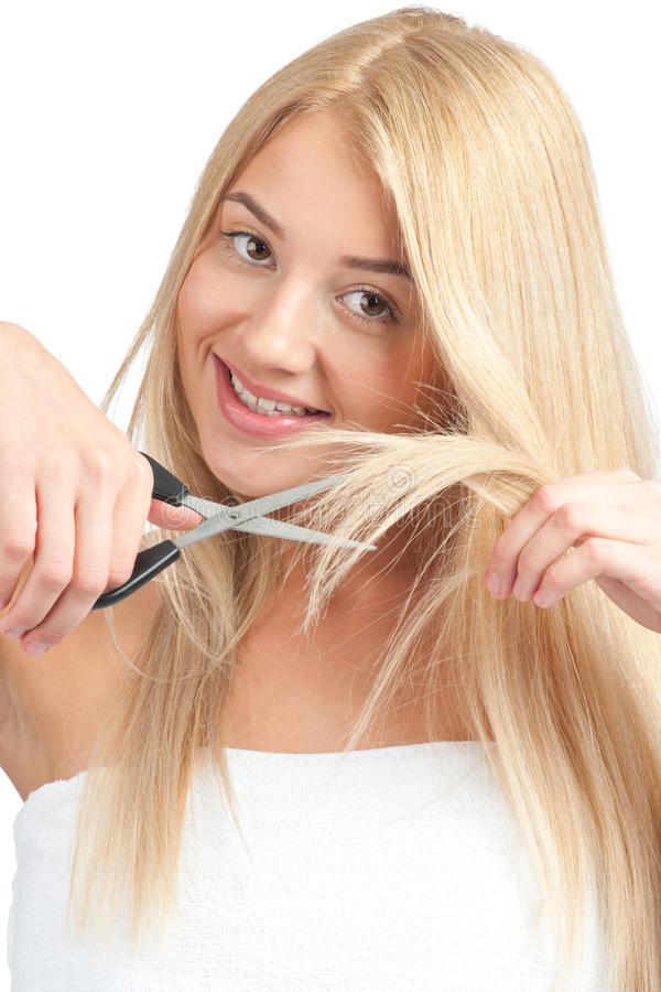 Woman Cutting Her Hair With Scissors Stock Image