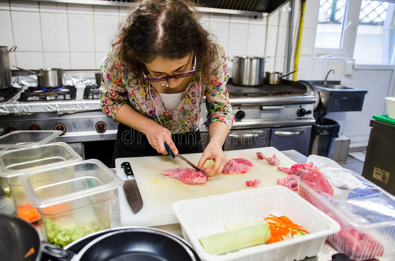 Woman cutting meat royalty free stock images