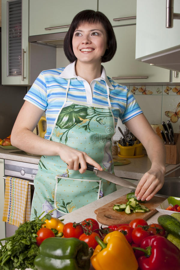 Free Woman Cutting Vegetables In The Kitchen. Stock Images - 13630544