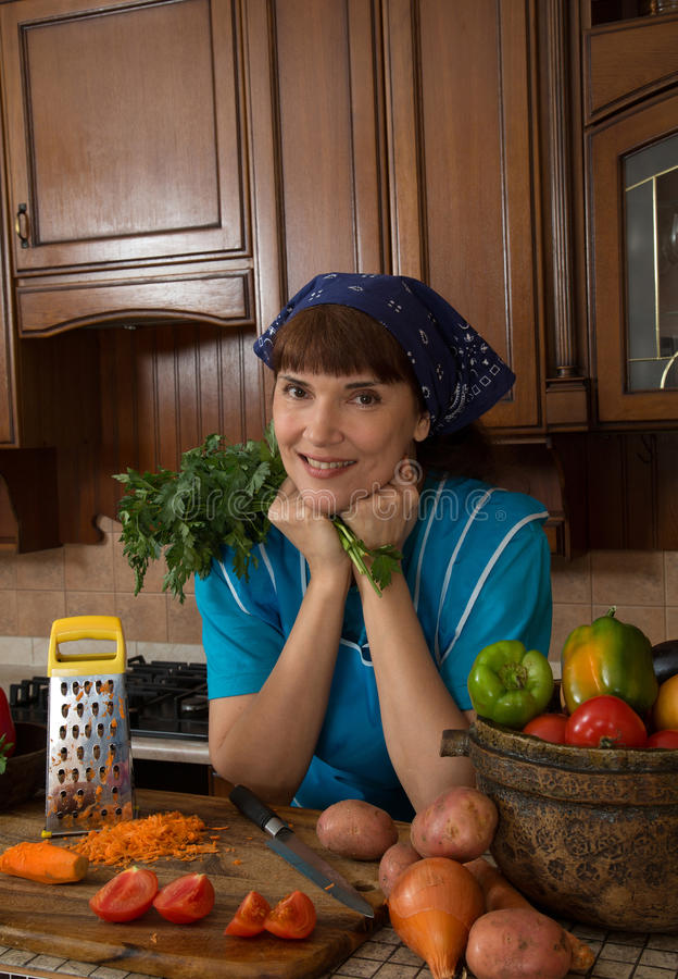 Woman cutting vegetables in the kitchen stock images