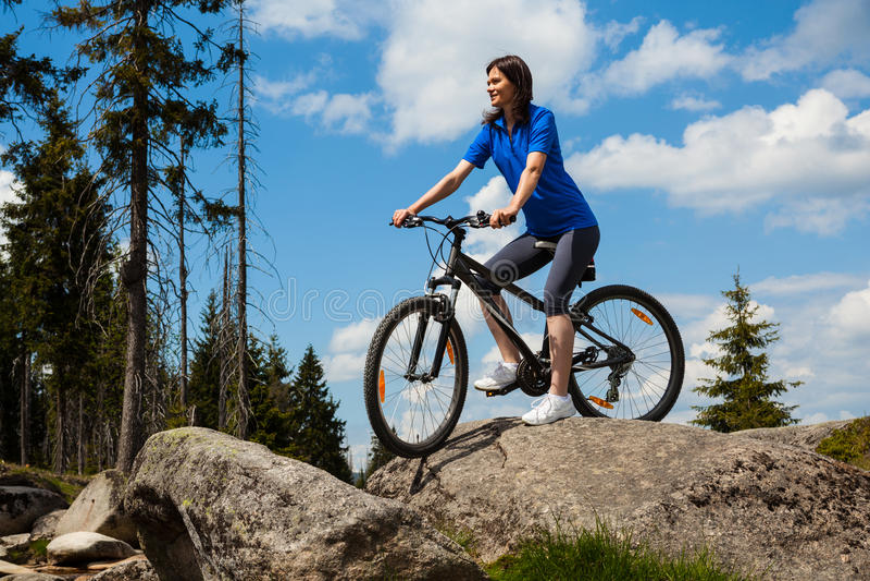 Woman cycling stock image