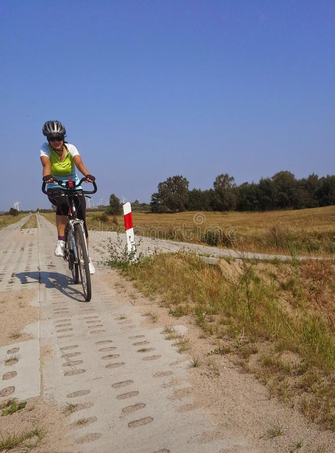 Woman cycling royalty free stock photography