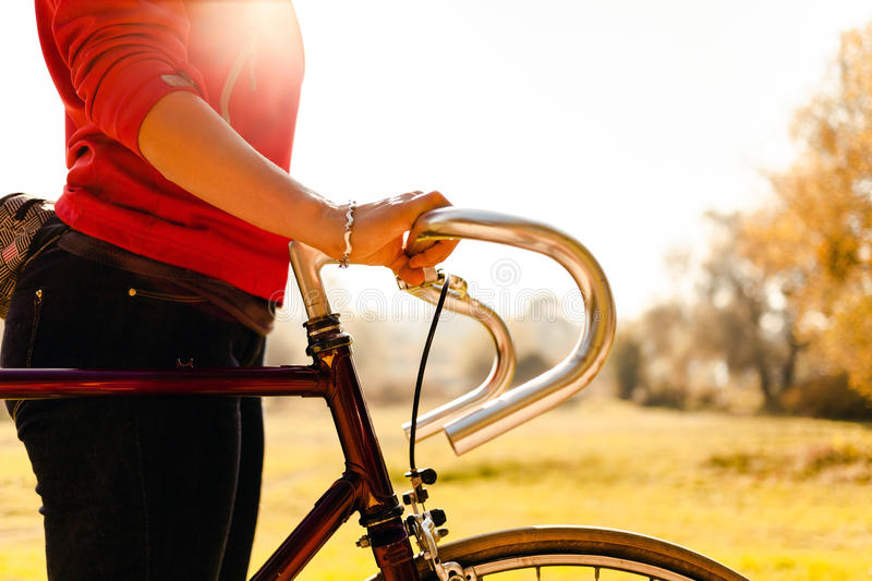 Download Woman Cycling On Bicycle In Autumn Park Stock Photo - Image: 27795636