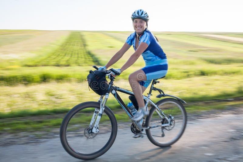 Woman cycling stock photos