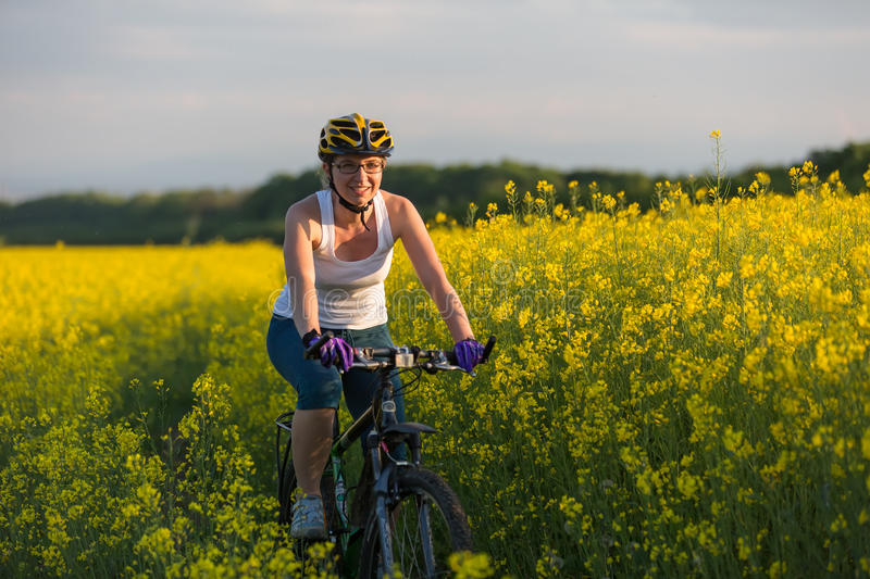 Woman is cycling stock photos