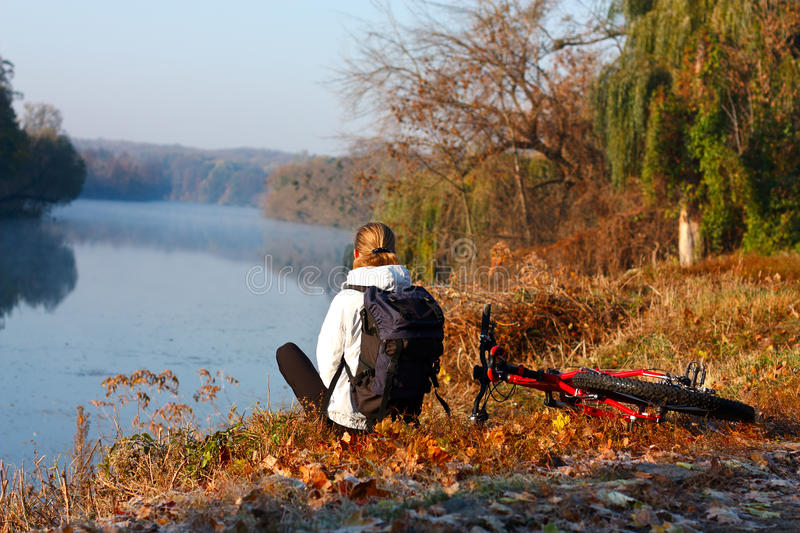 Download Woman Cyclist Recreation On The River-side Royalty Free Stock Images - Image: 22461709