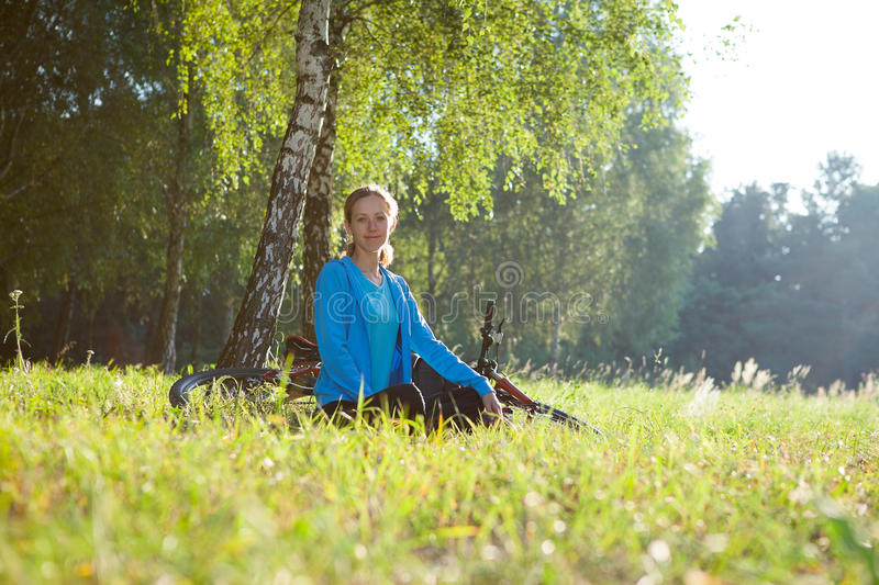 Download Woman Cyclist Relaxing In Spring Park Stock Photo - Image: 27846866