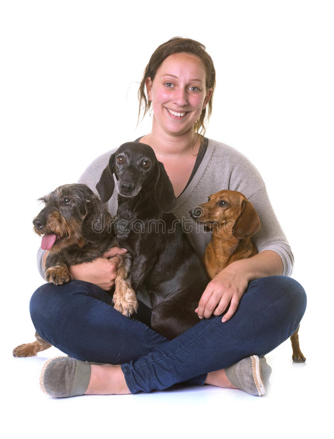 Woman and dachshunds stock photo