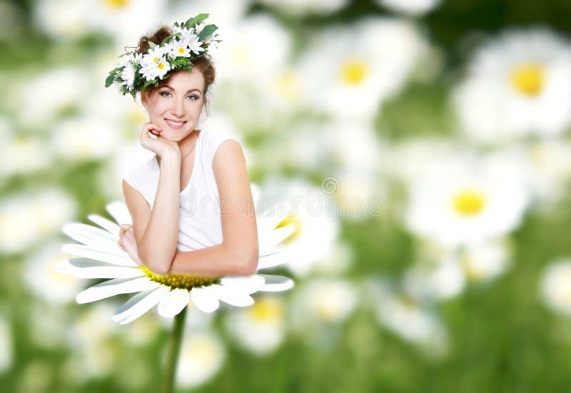 Woman on daisy flower stock image