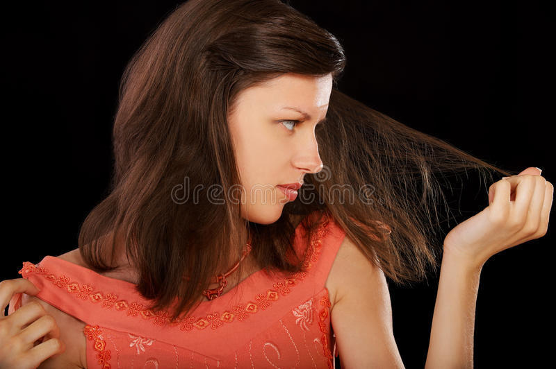 Woman with damaged hair stock images