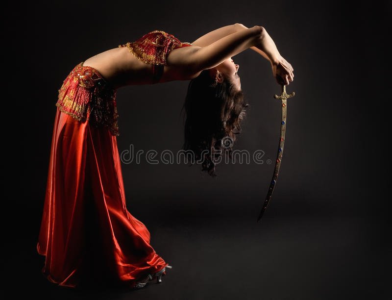 Woman dance with saber. Brunette woman dance with saber stock photography