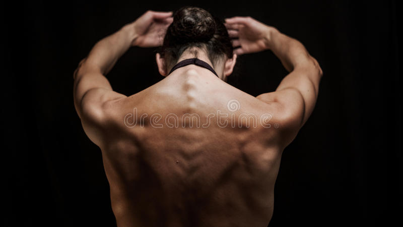 Woman dancer from behind in a ballet pose royalty free stock photography