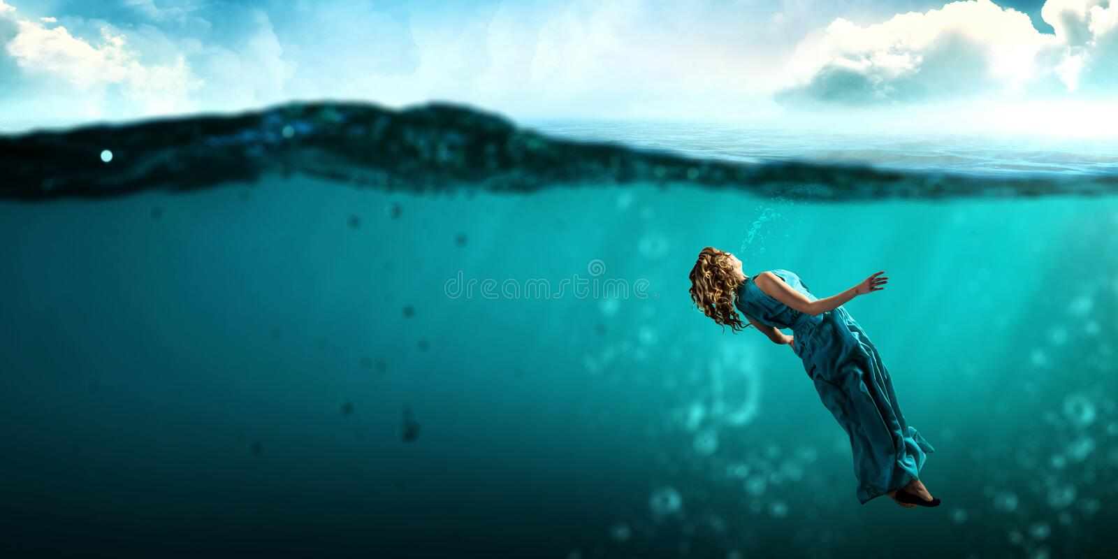 Woman dancer in clear blue water stock photography