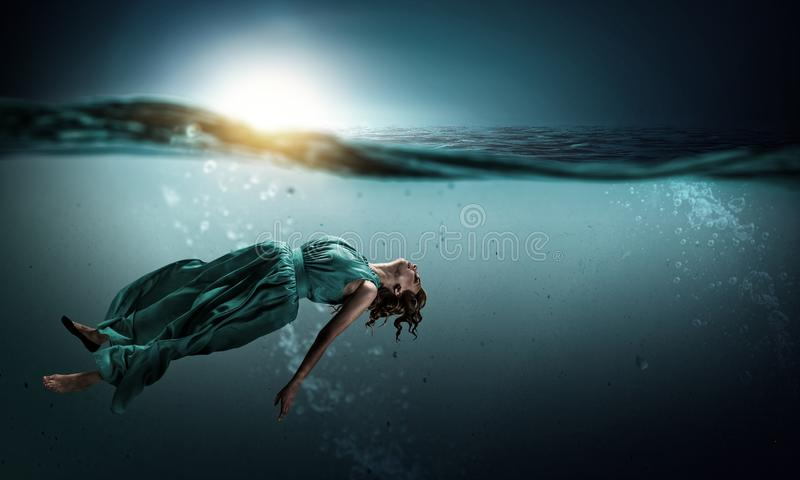 Woman dancer in clear blue water royalty free stock images