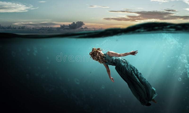 Woman dancer in clear blue water royalty free stock image
