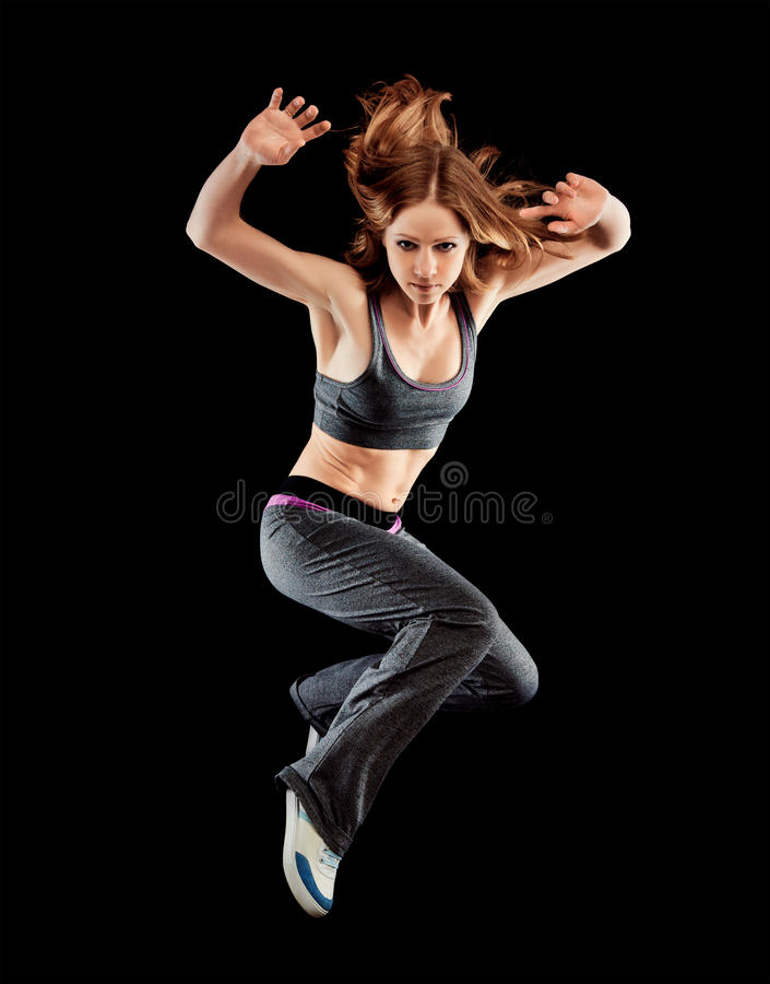 Woman dancer dancing modern dance, jump on a black stock images