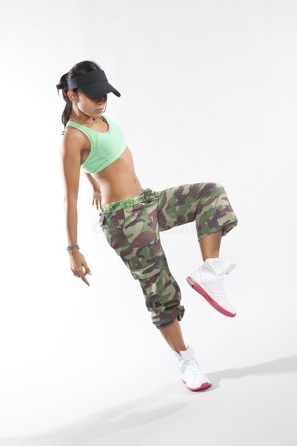 Woman dancer in hip hop attire striking a pose stock photos