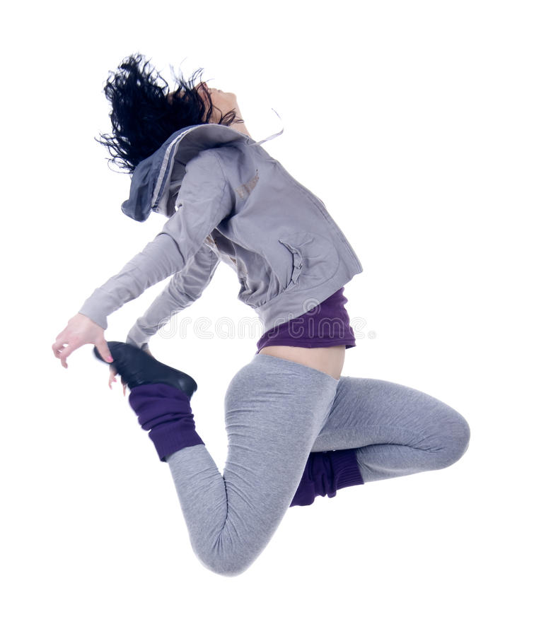 Woman dancer jumping. Picture of a woman dancer jumping on a white background stock photography