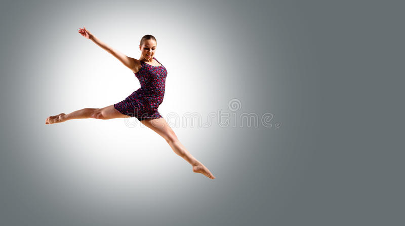 Woman dancer jumping royalty free stock images