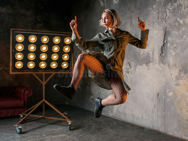 woman dancer jumping high in the loft royalty free stock photo