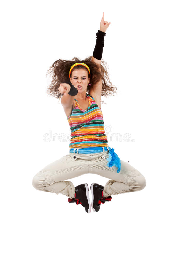 Woman dancer jumping and poiting. Young woman dancing hip-hop and pointing at the camera . woman dancer jumping and poiting to the camera stock photo