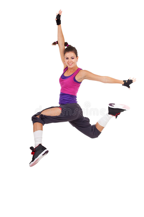 Woman dancer making a jumping dance move royalty free stock images