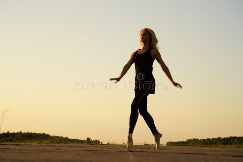Woman Dancer Posing On Concrete Road Stock Photo