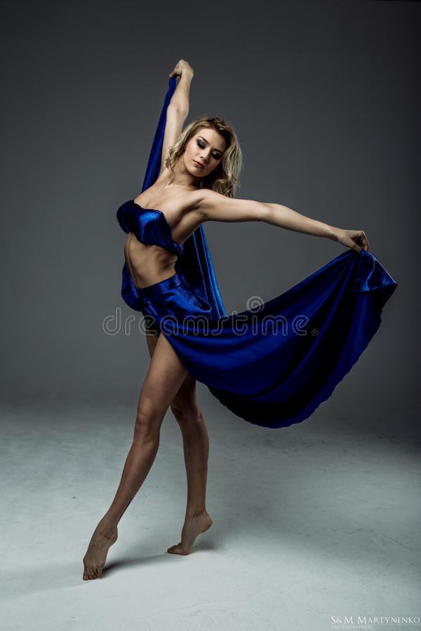 Woman dancer wearing blue skirt royalty free stock photography