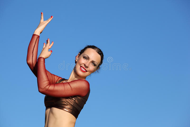 Woman dances at background of sky stock photo