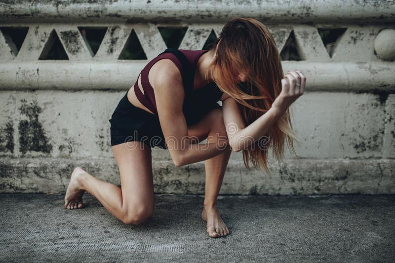 Woman performing dance on the floor. stock images