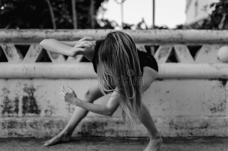 Woman performing dance on the floor. Black and white stock image