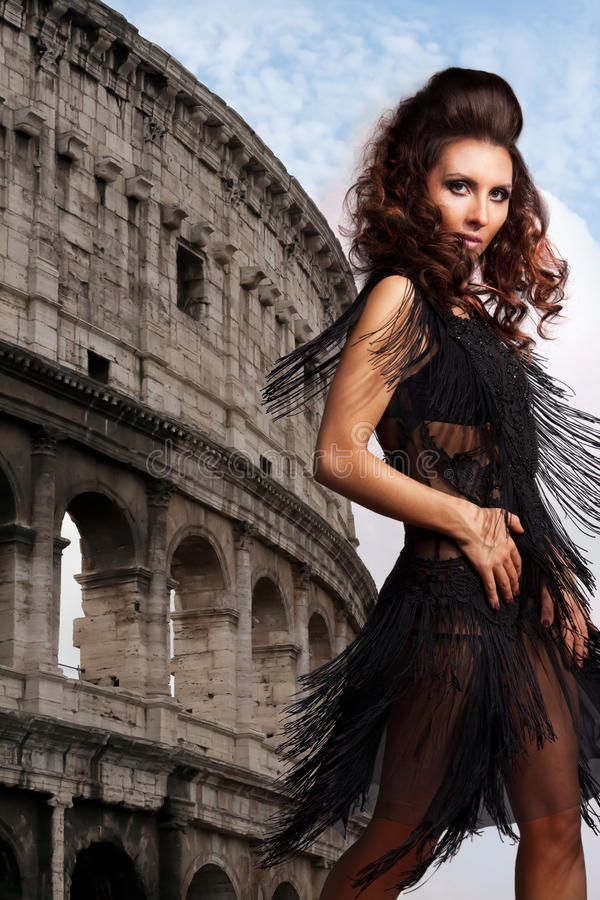 Woman dancing on with a coliseum on a background royalty free stock photography