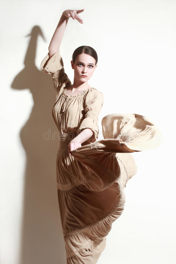 Woman dancing flamenco dancer in long flying dress. Woman dancing flamenco dancer Woman in long flying dress royalty free stock photography