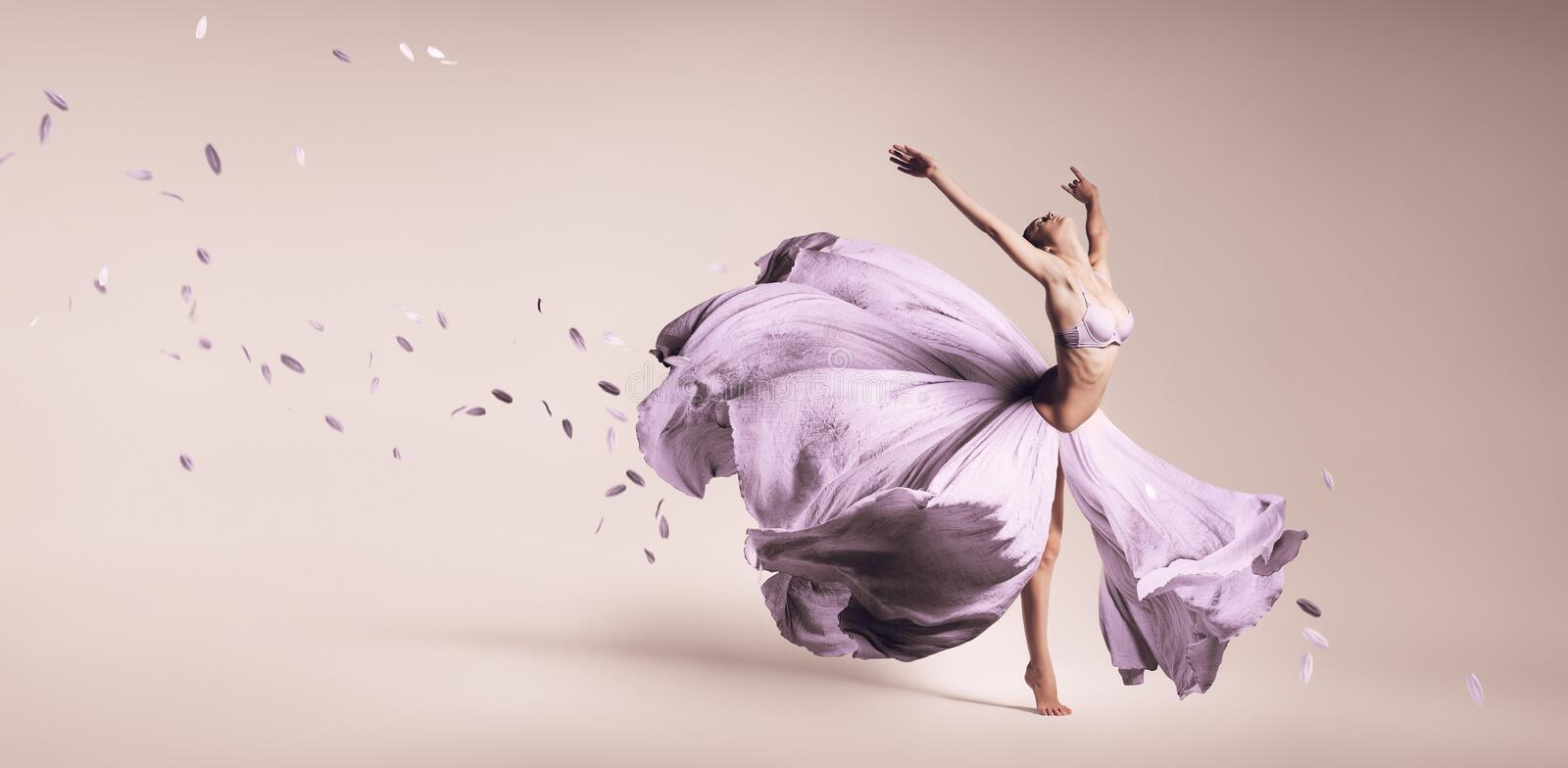 Woman dancing in flowing purple dress stock photos