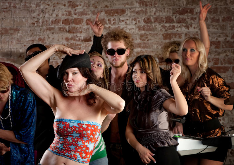 Woman dancing with friends at disco party royalty free stock photography