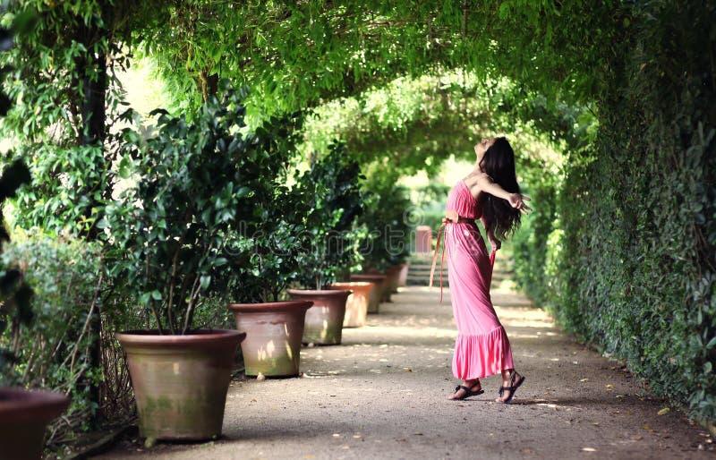Woman dancing in garden passage royalty free stock photos