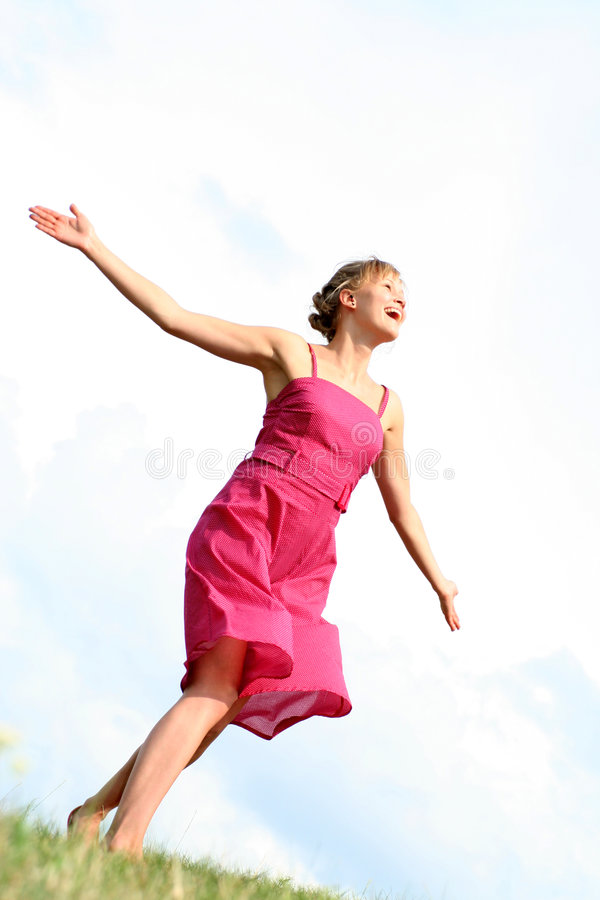 Woman Dancing On Grass Royalty Free Stock Image
