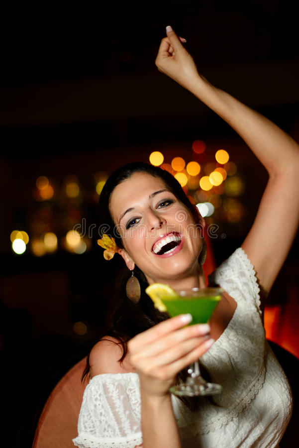 Woman dancing and having fun at night club stock photo